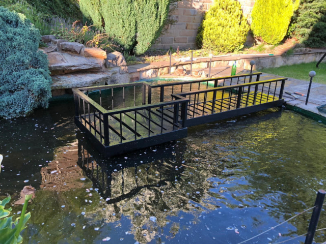Bridge and pontoon in a customers Koi Pond